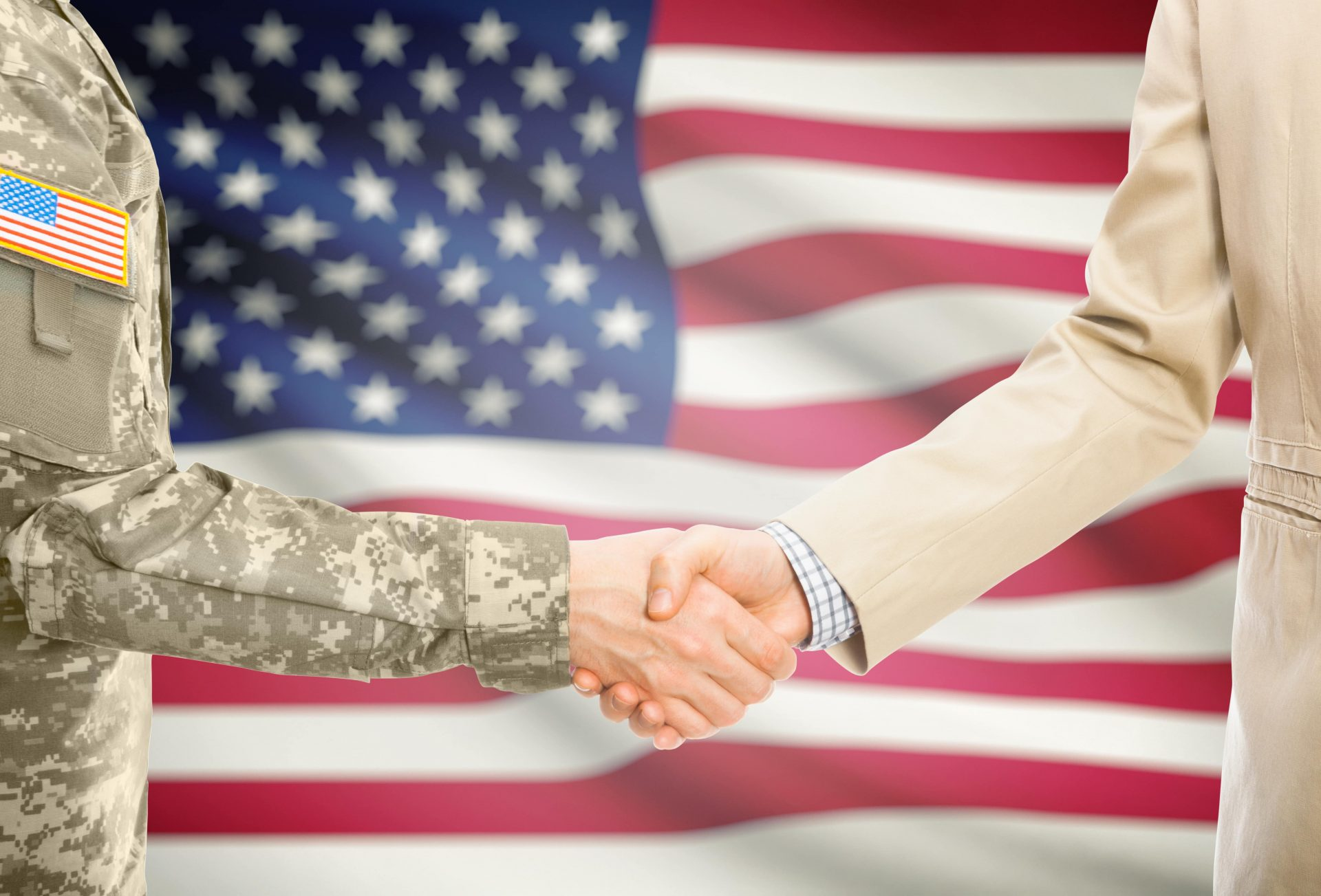 soldier shaking hand with businessman
